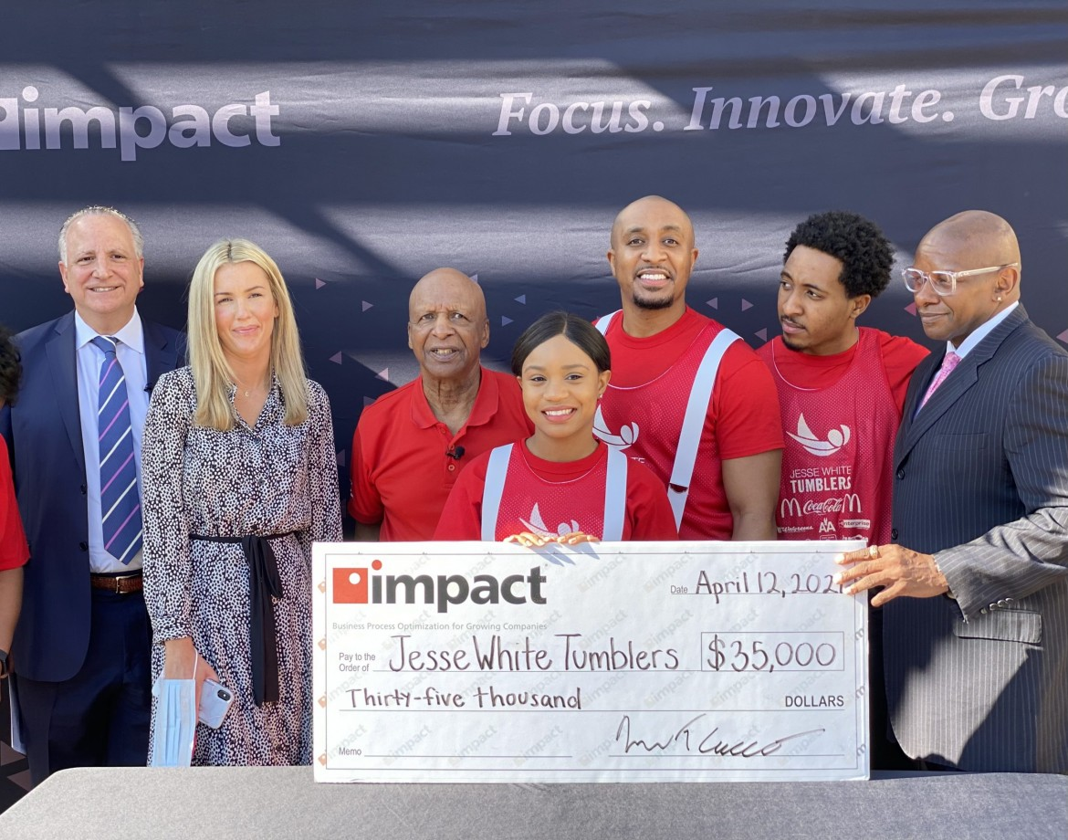 Impact Donates $35,000 to the Jesse White Tumbling Team